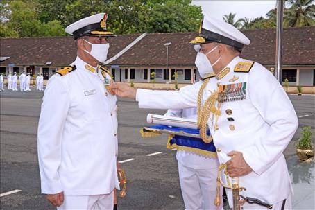Group  Commander NCC Group  Ernakulam  receiving the VSM from FOC-in-C South  in an Investiture ceremony at the Naval Base